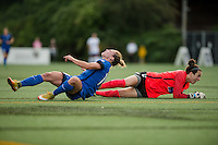 Seattle, WA - Saturday, July 02, 2016: Boston Breakers goalkeeper Jami Kranich (2) collides with Seattle Reign FC forward Manon Melis (14) during a regular season National Women's Soccer League (NWSL) match between the Seattle Reign FC and the Boston Breakers at Memorial Stadium. Seattle won 2-0.