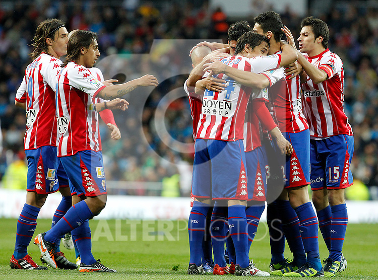 (L to R) Sporting de Gijon's Gaston Maximiliano Sangoy, Damian Suarez, Alberto Lora, Ivan Hernandez, Oscar Guido Trejo, Alberto Tomas Botia and Roberto Canella celebrate goal during La Liga match.April 14,2012. (ALTERPHOTOS/Acero)