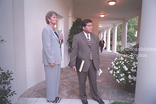 Counselor Karen Hughes and Counsel Alberto Gonzales wait on the Colonnade for United States President George W. Bush to arrive at the White House, Tuesday, September 11, 2001..Mandatory Credit: Paul Morse - White House via CNP.