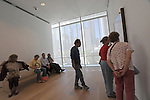 """Visitors are seen in a gallery in the recently unveiled Modern Wing of the Art Institute Chicago, designed by architect Renzo Piano on the first """"free Tuesday"""" where admission costs nothing and is open to the public, in Chicago, Illinois on May 19, 2009."""
