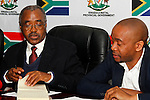 DURBAN - 30 October 2016 - Willies Mchunu (left), the premier of South Africa's KwaZulu-Natal province, speaks at a press conference about the establishment of a Commission of Inquiry to investigate political violence in the province. In the run up to the country's local government (municipal) elections at least 20 local politicians were killed in 2016 alone. Looking on is his spokesman Ndabesinhle Sibiya (right). Picture: Allied Picture Press/APP
