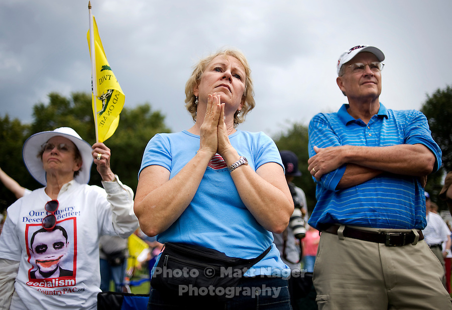 Susan Johnston (cq, middle) and Steve Johnston (cq, right) watch during a memorial prayer for US war veterans during a Tea Party Express rally at Indian Spring Park in Waco, Texas, Thursday, September 3, 2009. The Tea Party Express is heading to Washington, DC where it will hold a final rally against higher government spending, higher taxes, and President Obama's push to reform health care...MATT NAGER/ SPECIAL CONTRIBUTOR