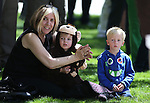 Barbara Nicholas sits with her grandson Hunter Nicholas and friend Carter Mason, both 4, during the annual Law Enforcement Officers Memorial ceremony on Thursday, May 1, 2014, in Carson City, Nev. (Las Vegas Review-Journal/Cathleen Allison)