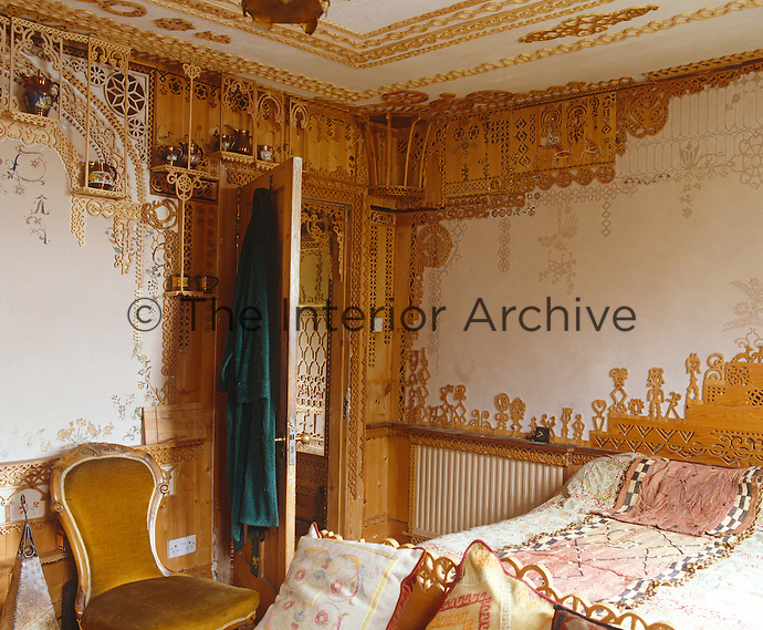 The pencilled outlines on the bedroom walls show that this ornate fretwork is still very much a work in progress