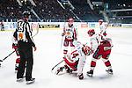 Stockholm 2013-12-28 Ishockey Hockeyallsvenskan Djurg&aring;rdens IF - Almtuna IS :  <br /> Almtuna Sebastian Hartmann har skadat sig i den f&ouml;rsta perioden och tittas till av Almtuna Fredrik Sandgren och Almtuna Johan Berggren <br /> (Foto: Kenta J&ouml;nsson) Nyckelord:  skada skadan ont sm&auml;rta injury pain
