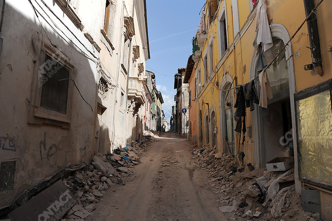 In the historic centre of L'Aquila, from which 50,000 people were evacuated in the wake of the devastating earthquake of early April, many streets remain empty and filled with rubble as the emergency services begin repairs on the seriously damaged churches and state buildings and are still checking every house for damage evaluation. May 24, 2009
