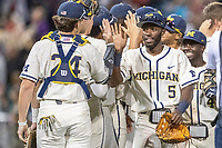Michigan Wolverines outfielder Christian Bullock (5) celebrates beating the Vanderbilt Commodores in Game 1 of the NCAA College World Series Finals on June 24, 2019 at TD Ameritrade Park in Omaha, Nebraska. Michigan defeated Vanderbilt 7-4. (Andrew Woolley/Four Seam Images)