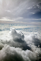 CLOUDS: VIEW FROM AIRPLANE<br /> Swelling cumulus &amp; cirrus
