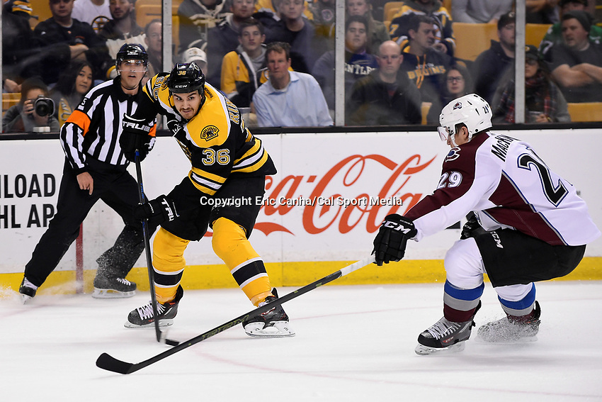 Thursday, November 12, 2015: Boston Bruins center Zac Rinaldo (36) plays the puck in his offensive zone with pressure from Colorado Avalanche center Nathan MacKinnon (29) during the National Hockey League game between the Colorado Avalanche and the Boston Bruins held at TD Garden, in Boston, Massachusetts. Eric Canha/CSM