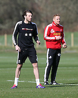 Pictured L-R: Michu and manager Garry Monk. Saturday 08 March 2014<br /> Re: Swansea City FC training at the Fairwood Training ground in the outskirts of Swansea, south Wales.