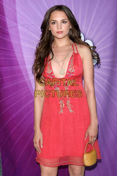 RACHEL LEIGH COOK.Las Vegas Cocktail Party held at The Beverly Hilton, Beverly Hills, CA..July 24th, 2005.Photo credit: Jacqui Wong/AdMedia.half length pink embroidered dress plunging neckline necklaces little tiny yellow purse bag.www.capitalpictures.com.sales@capitalpictures.com.© Capital Pictures.