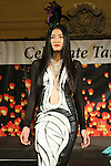 Model walks runway in an outfit from the Alexander King Chen Spring 2015 collection, during the Celebrate Taiwan event in Grand Central Terminal on September 27, 2014.