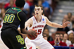 Wisconsin Badgers forward Sam Dekker (15) defends Baylor Bears forward Royce O'Neale (00) during the fourth-round game in the NCAA college basketball tournament Thursday, March 27, 2014 in Anaheim, California. The Badgers won 69-52. (Photo by David Stluka)