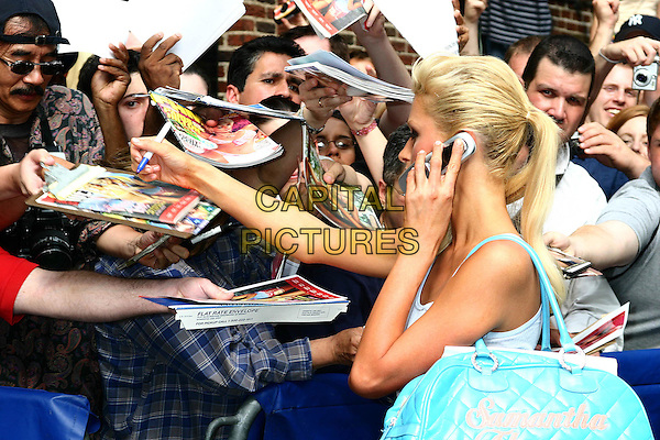 PARIS HILTON.At the David Letterman Show in .New York City,.June 14th 2004..portrait headshot talking on mobile phone signing autographs turquoise bag.www.capitalpictures.com.sales@capitalpictures.com.©Capital Pictures