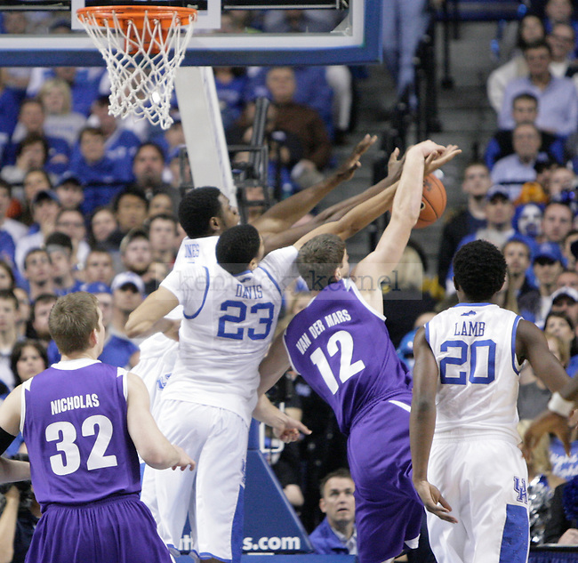 Terrence Jones and Anthony Davis fight for a rebound against Portland at Rupp Arena on Saturday, Nov. 26, 2011. Photo by Scott Hannigan | Staff