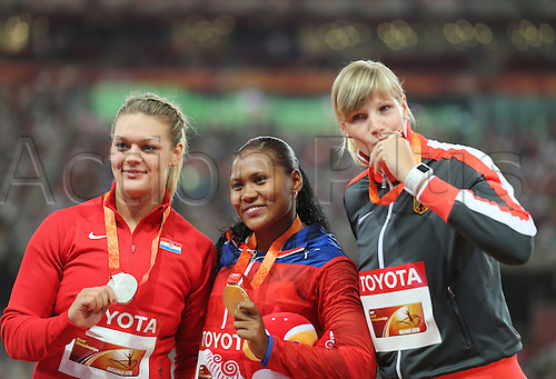 25.08.2015. Beijing, China.  Nadine Mueller (R)ofGermany poses with her bronze medal next to gold medalist Denia Caballero (C) of Cuba and silver medalist Sandra Perkovic (L) of Croatia after the women's Discus Throw final of the Beijing 2015 IAAF World Championships at the National Stadium, also known as Bird's Nest, in Beijing, China, 25 August 2015.