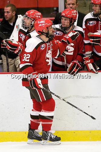Aaron Bogosian (St. Lawrence - 32) - The Harvard University Crimson defeated the St. Lawrence University Saints 4-3 on senior night Saturday, February 26, 2011, at Bright Hockey Center in Cambridge, Massachusetts.