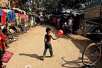 A child plays with a balloon in the Mirpur slum in Dhaka.