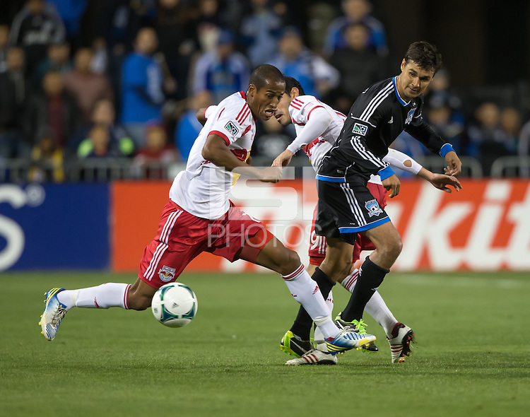 March 10th, 2013: Roy Miller controlling the ball alongside with Chris Wondolowski during a game at Buck Shaw Stadium, Santa Clara, Ca.   Earthquakes defeated Red Bulls 2-1