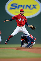 Second baseman Korby Batesole (12) of the Greenville Drive watches his throw to first after turning a double play on Justin Dean (5) of the Rome Braves on Friday, April 19, 2019, at Fluor Field at the West End in Greenville, South Carolina. Greenville won, 2-0. (Tom Priddy/Four Seam Images)
