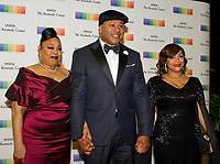 LL COOL J, center, arrives with his Mother, Andrea Smith, left and his wife, Simone Smith, right, for the formal Artist's Dinner honoring the recipients of the 40th Annual Kennedy Center Honors hosted by United States Secretary of State Rex Tillerson at the US Department of State in Washington, D.C. on Saturday, December 2, 2017. The 2017 honorees are: American dancer and choreographer Carmen de Lavallade; Cuban American singer-songwriter and actress Gloria Estefan; American hip hop artist and entertainment icon LL COOL J; American television writer and producer Norman Lear; and American musician and record producer Lionel Richie. Photo Credit: Ron Sachs/CNP/AdMedia