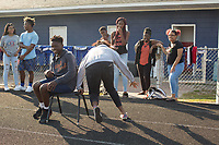Fresmen Jermaine Moore, 14 (CQ), and January Richards, 14, (CQ) play musical chairs during a Peer Group Connection field day where freshmen students meet their senior mentors at Greene Central Central High School in Snow Hill, NC Friday, September 22, 2017. (Justin Cook for Education Week)