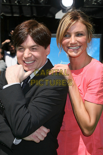 "MIKE MYERS & CAMERON DIAZ.Attending ""Shrek the Third"" Los Angeles Premiere at Mann's Village Theatre, Westwood, California, USA, .6 May 2007 .half length pink coral dress hand on shoulder.CAP/ADM/BP.©Byron Purvis/AdMedia/Capital Pictures."