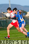 An Ghaeltacht Sean Micheal Ó Conchúir in possession of the ball tackled by Keel Donal O' Neill during the County League Div. 3 match at Gallarus on Sunday afternoon.