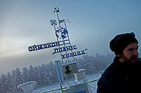 A visitor at the Pole of Cold monument in the village of Oymyakon. The village is known as the Northern Pole of Cold as it has recorded the lowest ever temperatures for an inhabited place on earth, the coldest being -67.7 degrees celcius.