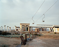 A rusting chairlift. During Soviet times the lift used to take guests from the holiday camp on the hill down to the beach resort below. The neighbouring beach is now out of bounds, as the Azeri president has built a luxurious holiday home, surrounded by high walls, on its shores by the Caspian Sea.