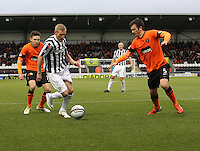 Gary Teale takes on Gavin Gunning watched by Ryan Dow in the St Mirren v Dundee United Clydesdale Bank Scottish Premier League match played at St Mirren Park, Paisley on 27.10.12.