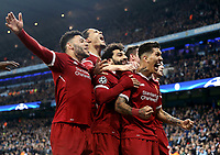 Liverpool's Roberto Firmino (centre) celebrates with team-mates after scoring his side's second goal <br /> <br /> Photographer Rich Linley/CameraSport<br /> <br /> UEFA Champions League Quarter-Final Second Leg - Manchester City v Liverpool - Tuesday 10th April 2018 - The Etihad - Manchester<br />  <br /> World Copyright &copy; 2017 CameraSport. All rights reserved. 43 Linden Ave. Countesthorpe. Leicester. England. LE8 5PG - Tel: +44 (0) 116 277 4147 - admin@camerasport.com - www.camerasport.com
