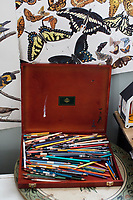 Colored pencils rest on a table in Jada Fitch's living room, which doubles as her art studio, in Portland, Maine, USA, on Fri., July 28, 2017. Fitch has recently been making birdhouses that look like living rooms with small portraits of birds. The birdhouses sell out within minutes on her Etsy store.
