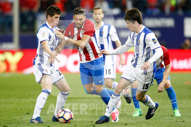 Atletico de Madrid's Yannick Ferreira Carrasco (c) and Real Sociedad's Igor Zubeldia (l) and Aritz Elustondo during La Liga match. April 4,2017. (ALTERPHOTOS/Acero)