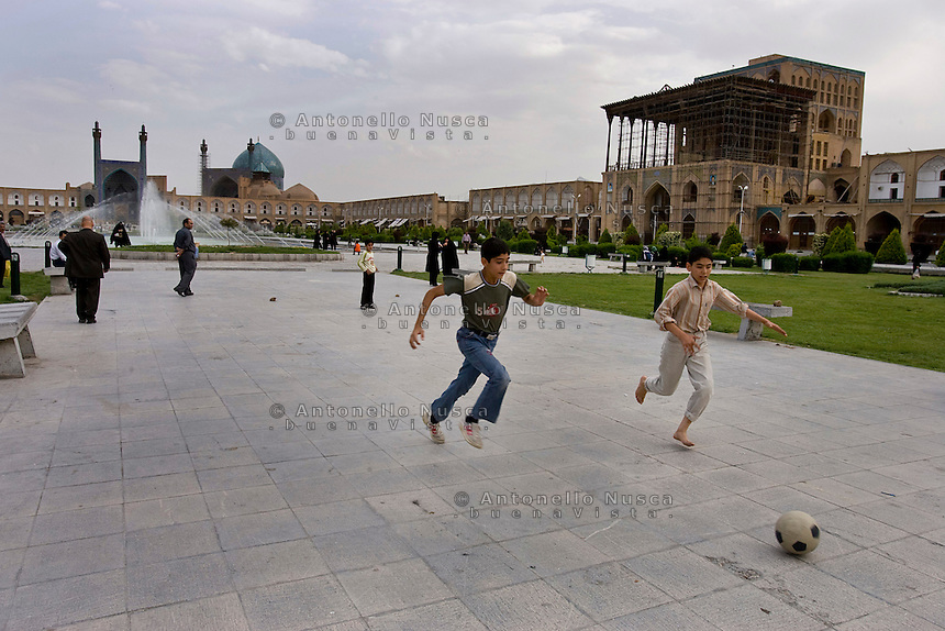 Youths playing football at the Naqsh-e Jahan Square now called Imam Square in Esfahan, Iran May 4,  2007. This is the second largest square in the world and designed by Unesco as a universal heritage site.