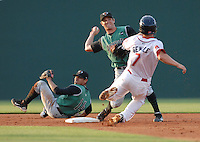 Second baseman Ryan Cavan (15) of the Augusta GreenJackets makes the first half of a double play after getting a toss from shortstop Juan Martinez (14) to start a double play during Spartanburg Night with the Greenville Drive on June 8, 2010, at Fluor Field at the West End in Greenville, S.C. Photo by: Tom Priddy/Four Seam Images