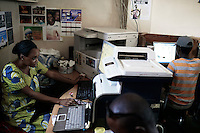 ACCRA, GHANA APRIL 17: An owner sits at a computers in her Internet café on April 17, 2015 in Zongo Area in central Accra, Ghana. Most customers work on Romance scams, credit card fraud and etc. The country is a center for different online scams. Both men and women are lured to send cash to someone they only met on the net.  Due to limited opportunities, many youngsters spend their days in Internet cafes trying to scam people form all over the world. (Photo by: Per-Anders Pettersson)