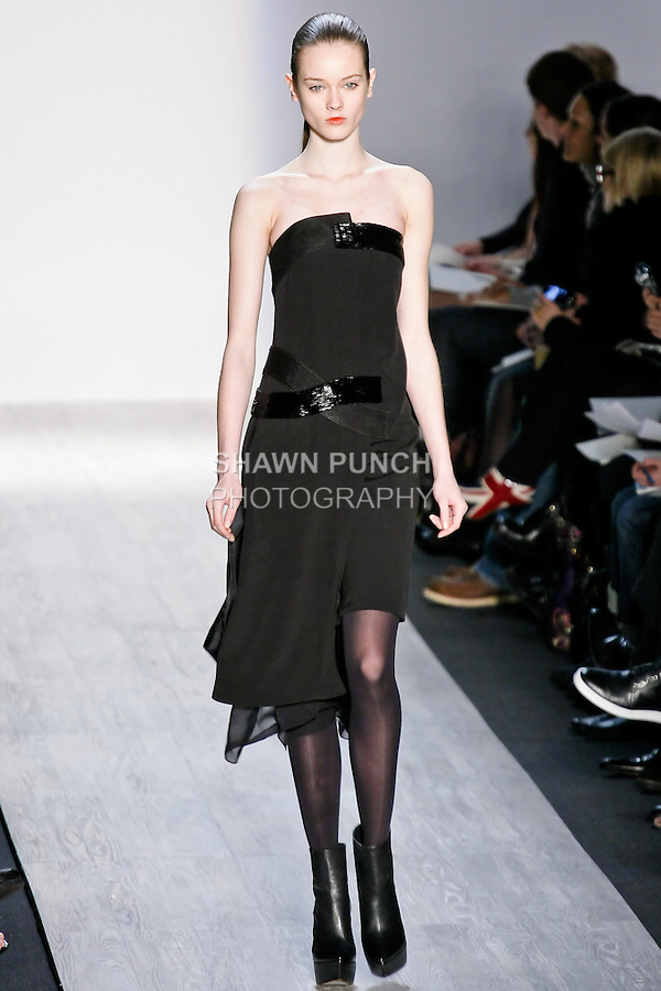 Jac walks the runway in black tights, black strapless crepe dress with beaded detail, and black platform boot, by designer Max Azria for the Max Azria Fall 2010 collection fashion show, during Mercedes-Benz Fashion Week Fall 2010.