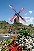 Belgium, West Vlaanderen, De Panne: Windmill amongst sand dunes, cyclist