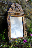 Detail of astrologer Sarah Bartlett's ancient mirror that she uses for scrying, photographed in the garden of her home, Mandelieu-la-Napoule, France, 03 May 2012
