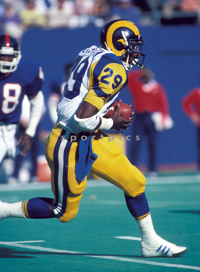 Los Angeles Rams Eric Dickerson (29) during a game against the New York Giants on November 10, 1985 at Giants Stadium in East Rutherford, New Jersey. The Giants beat the Rams 24-19. Eric Dickerson played for 11 years with 4 different teams, was a 6-time Pro Bowler and was inducted to Pro Football Hall of Fame in 1999.