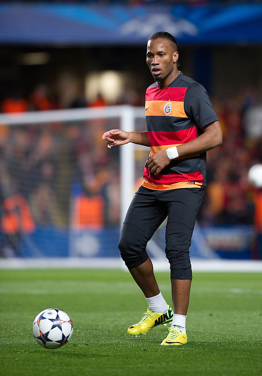 Galatasaray's Didier Drogba during the pre-match warm-up <br /> <br /> Photo by Ashley Western/CameraSport<br /> <br /> Football - UEFA Champions League First Knockout Round 2nd Leg - Chelsea v Galatasaray - Tuesday 18th March 2014 - Stamford Bridge - London<br />  <br /> &copy; CameraSport - 43 Linden Ave. Countesthorpe. Leicester. England. LE8 5PG - Tel: +44 (0) 116 277 4147 - admin@camerasport.com - www.camerasport.com