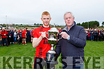 Mid Kerry Chairman Mike Sayers presents the Glenbeigh/Glencar captain Kieran Doyle the Michael O'Connor memorial cup after they defeated Laune Rangers in the Mid Kerry final in Killorglin on Sunday