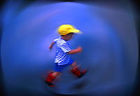 Boy Jumping Over Rain Puddle. Digitally enhanced photograph. Child Running.