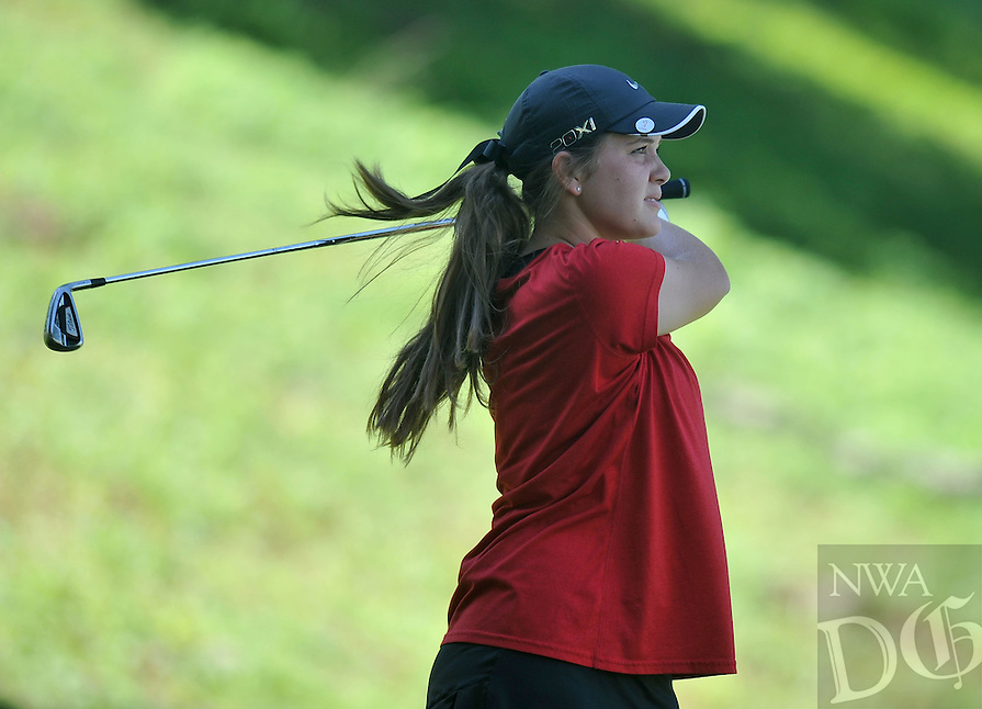 NWA Media/Michael Woods --06/24/2014-- w @NWAMICHAELW...Kristen Garner from Hot Springs watches her shot off the 10th tee Tuesday morning as she begins her last round of the ASGA Stroke Play tournament at Shadow Valley Country Club in Rogers.