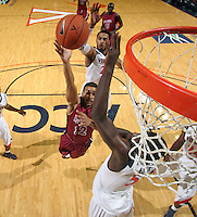 Nov 6, 2010; Charlottesville, VA, USA; Roanoke College g Melvin Felix (12) shoots the ball between Virginia Cavalier defenders Saturday afternoon in exhibition action at John Paul Jones Arena. The Virginia men's basketball team recorded an 82-50 victory over Roanoke College.