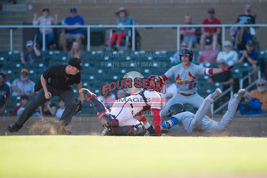 Salt River Rafters catcher Tres Barrera (12), of the Washington Nationals organization, applies the tag to Charles Leblanc (12) in front of home plate umpire Junior Valentine as Lane Thomas (23) looks on during an Arizona Fall League game against the Surprise Saguaros at Salt River Fields at Talking Stick on November 5, 2018 in Scottsdale, Arizona. Salt River defeated Surprise 4-3 . (Zachary Lucy/Four Seam Images)