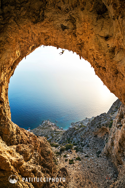 Climbing the wildly overhanging route George's, 8a+, in the enormous and difficult Crystal Cave, Telendos, Kalymnos, Greece.