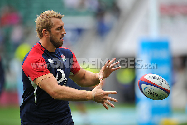 Chris Robshaw of England receives the ball during the pre-match warm-up. QBE International match between England and Ireland on September 5, 2015 at Twickenham Stadium in London, England. Photo by: Patrick Khachfe / Onside Images