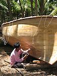 Long-tail, long-boat builder caulking boat. Koh Lanta, Thailand